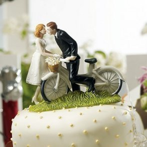 A Kiss Above Bicycle Bride & Groom Figurine